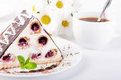 Cherry pie with mint and a cup of coffee, flowers, camomiles