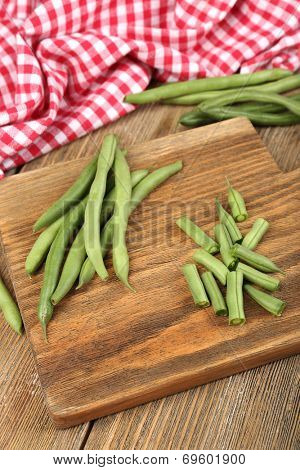 French beans on cutting board on table close-up