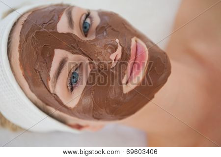 Beautiful blonde getting a chocolate facial treatment at the health spa