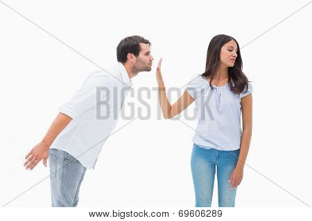 Brunette uninterested in mans advances on white background