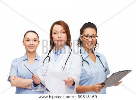 healthcare and medicine concept - calm female doctor adn nurses with clipboard and stethoscope giving prescription