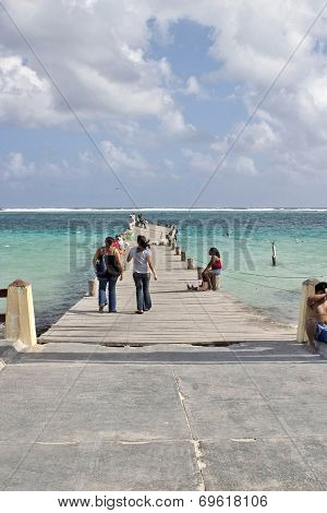 People on a twisted pier in Mexico