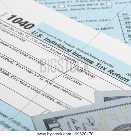 Us Tax Form 1040 With 100 Us Dollar Bills