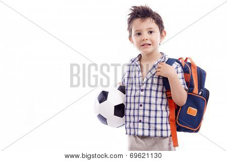 Happy school kid holding a soccer ball, isolated on white background