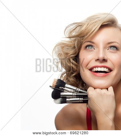 closeup portrait of attractive  caucasian smiling woman blond isolated on white studio shot lips toothy smile face hair head and shoulders looking up blue eyes tooth brushes makeup