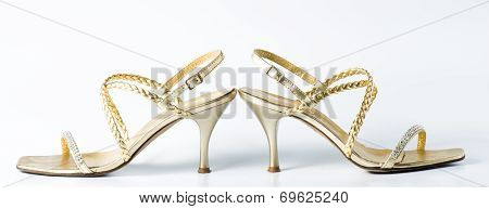 Woman Golden Shoes On White