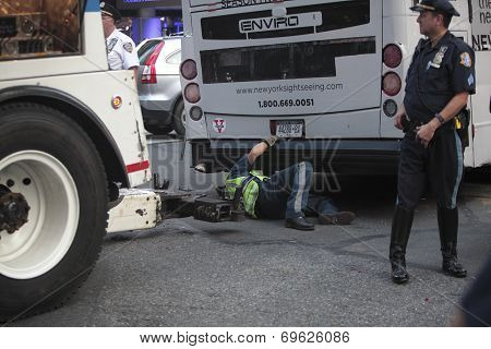 Attaching tow truck to bus undercarriage