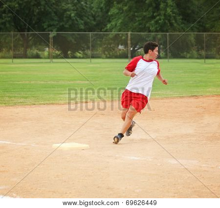 a woman running on a dirt field while playing a softball game