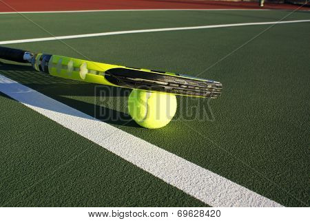 Tennis racquet on court
