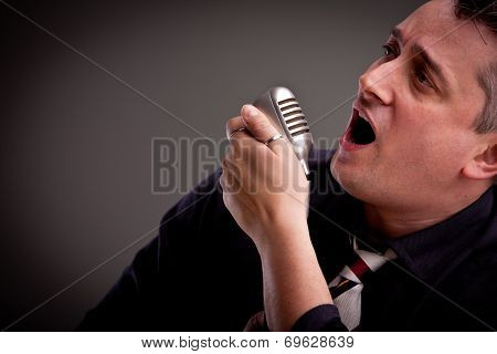 Fifties Style Singer On A Dark Background
