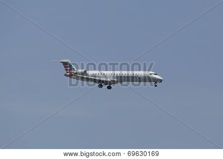 American Eagle Embraer ERJ-145 jet in New York sky before landing at JFK Airport
