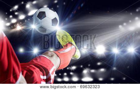 Close up image of footballer foot kicking the ball