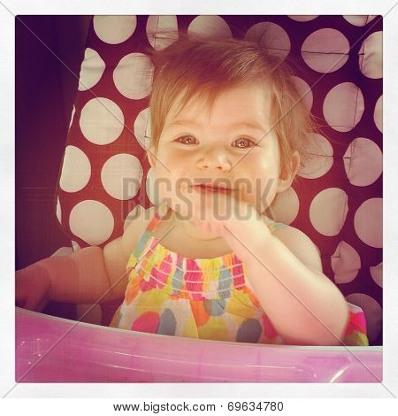 Baby girl in highchair- With Instagram effect