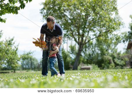 Father playing with his daughter outdoors