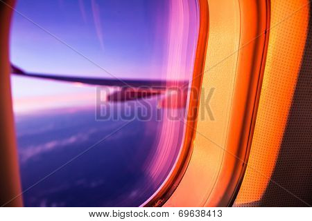 Airplane porthole at sunrise