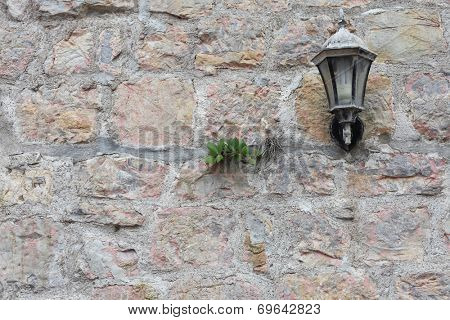 stone wall background with lantern