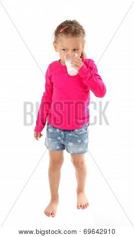 Little Girl Drinking Glas Of Milk