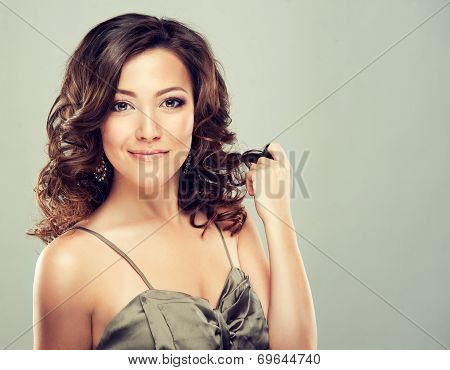Beautiful model with long curly hair , fashion makeup and red nails