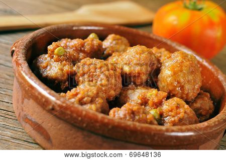 closeup of an earthenware bowl with a spanish meatballs stew