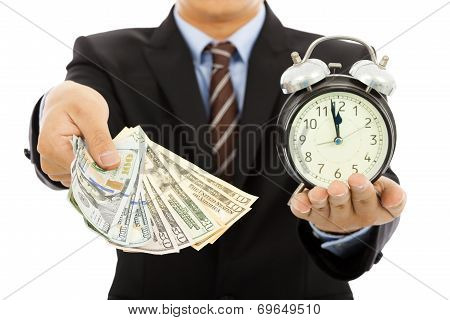 Businessman Holding Money And Clock. Time Is Money Concept