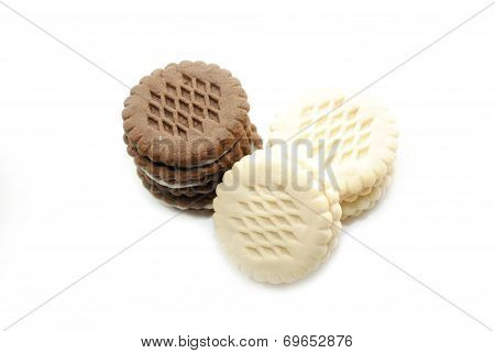 Vanilla And Chocolate Dessert Cookies On A White Background