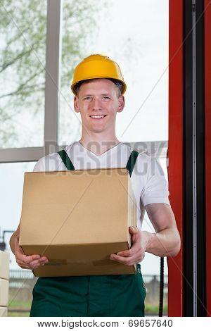 Workman Holding A Cardboard Box