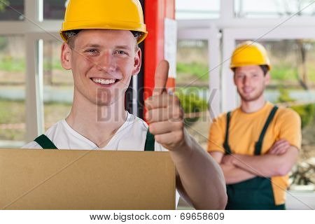 Smiling Warehouseman Showing Thumbs Up Sign