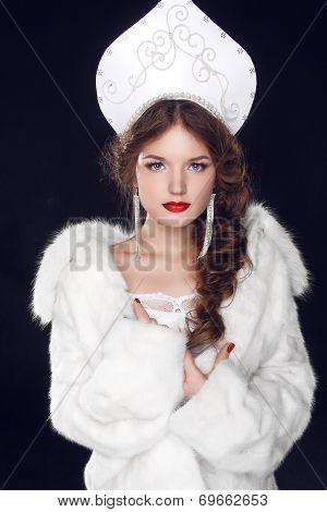 Fashion Russian Girl Model In Slavic Exclusive Design Clothes On Manners Old-slavic. Close-up Portra