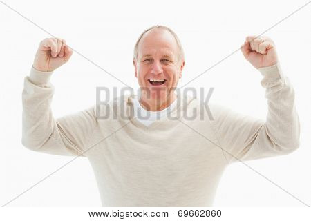 Happy mature man cheering at camera on white background