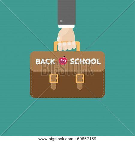 Hand Holding Brown Schoolbag Briefcase. Flat Design Style.