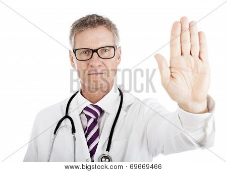 Stern Doctor Holding Up His Hand In A Halt Gesture