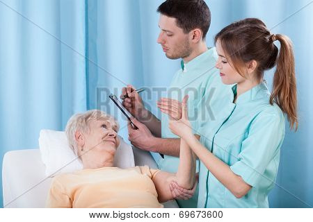 Physiotherapists Diagnosing Patient