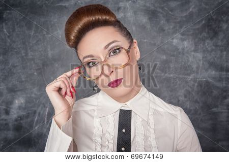 Strict Teacher In Eyeglasses Looking On Someone