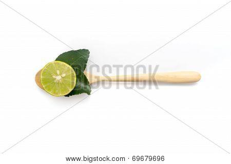 Lemon With Kaffir Lime Leaf Inside Spoon
