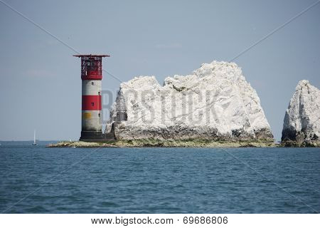 The Red And White Striped Lighthouse At The Needles In The Solent