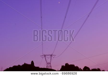 High tension power lines hill top twilight sunset