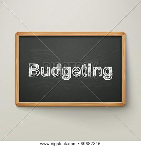 Budgeting On Blackboard In Wooden Frame