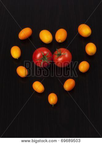 Juicy Organic Cherry Tomatoes And Kumquats