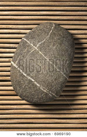 Stone On Bamboo