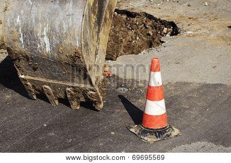 Public street maintenance works, excavator