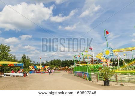 ALSACE, FRANCE - JUNE 19, 2014; Tourists at the amusement park on Didi'Land in Alsace, France. The Didi'Land is a popular destination with many attractions on Alsace, France.