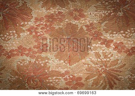 Old Tapestry Fabric Tinted Sepia With Vignetting Effect As Background