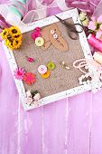 pic of sackcloth  - Scrapbooking craft materials and wooden frame with sackcloth inside on color wooden background - JPG