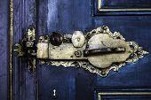 picture of door  - ancient gold door lock on blue door - JPG