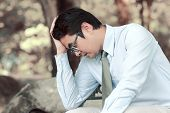 stock photo of hustler  - Asian men stress and hold the head with hand