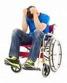 stock photo of handicap  - depressed and handicapped man sitting on a wheelchair - JPG