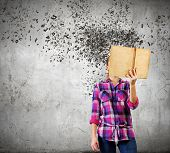 picture of incognito  - Young woman in casual hiding face behind reading - JPG