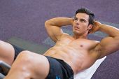 pic of abdominal  - High angle view of muscular man doing abdominal crunches in gym - JPG