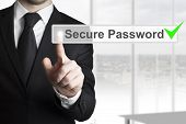 stock photo of intranet  - businessman in black suit pushing touchscreen secure password checked green - JPG