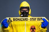 stock photo of scientist  - A scientist wearing a biological suit during an outbreak - JPG